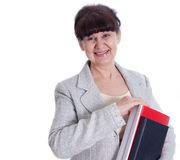 Aged woman posing like an administrator, secretary Stock Images