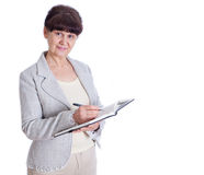 Aged woman posing like an office worker, administrator, secretary. Portrait against of white background Stock Images