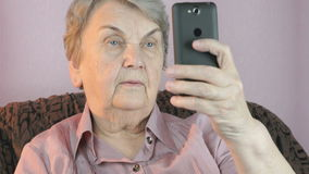 Aged woman 80s taking selfie using mobile phone stock video