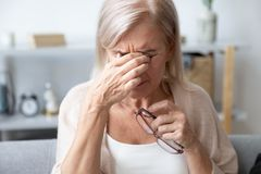 Free Aged Woman Taking Off Glasses Rubbing Eyelid Suffers From Eyestrain Stock Images - 165448534