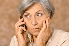 Aged woman talk on phone Royalty Free Stock Photo