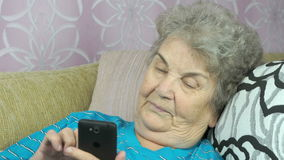 Aged woman talking with daughter on cellphone stock video