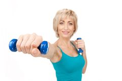 Aged woman workout using dumbbells. Stock Photography