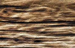 Aged Wood. Macro of aged sun lit wood on side of cabin stock image