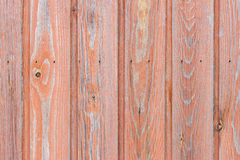 Aged wood board wall with red paint faded Stock Images