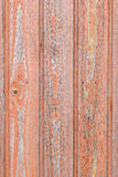 Aged wood board wall with red paint faded. Weathered wood board wall with red paint faded texture background royalty free stock photo
