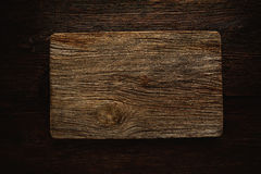 Aged wood cutting board as a copyspace Royalty Free Stock Image