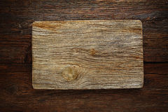 Aged wood cutting board as a copyspace Royalty Free Stock Photos