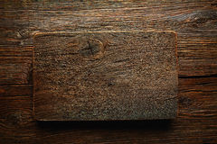 Aged wood cutting board as a copyspace Stock Photos