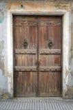 Aged wood door in Calella Stock Images