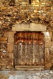 Aged wood door in medieval masonry Pyrenees Royalty Free Stock Photography