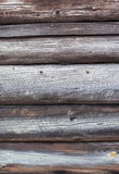Aged wood log wall texture Royalty Free Stock Images
