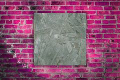 Aged wood square on pink bricks pattern Stock Images