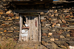 Aged wooden door in an ancient house Stock Photos
