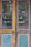 Aged wooden door with grid Royalty Free Stock Images