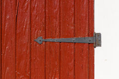 Aged wooden door and hinge Stock Image