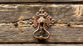 Aged wooden door and iron door handle Royalty Free Stock Photo