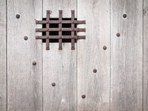 Aged wooden door with ironwork Stock Photos