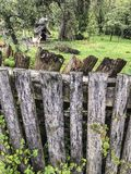 Aged wooden fence of a garden in spring. An aged wooden fence of a garden in spring royalty free stock photo