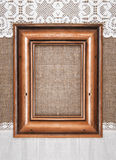 Aged wooden frame on the burlap Royalty Free Stock Photos