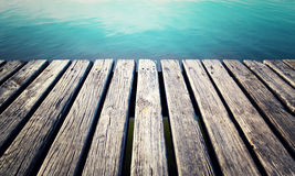 Aged wooden lake pier Royalty Free Stock Photo