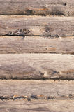 Aged wooden log wall with cracked surface Stock Photography