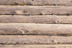 Aged wooden log wall with cracked surface Stock Photos