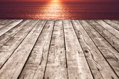 Aged wooden pier at sunset Royalty Free Stock Photography