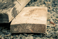Aged wooden planks on stones Stock Image