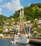 An old island ferry used for tourist excursions tied to a dock in the windward islands Stock Images