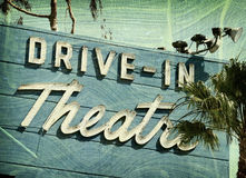 Aged and worn neon sign. Aged and worn vintage photo of drive-in theater sign Stock Photography