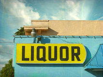 Aged and worn vintage liquor store sign Royalty Free Stock Images