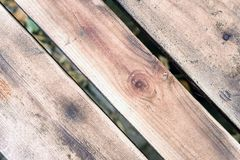 Aged Worn Wooden Planks. Naturally aged wooden planks in a diagonal format with grains of wood and wooden textures Stock Photo