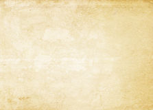 Aged yellowed paper texture or background. Old yellowed paper texture for the design. Grunge paper Royalty Free Stock Images