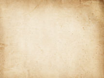 Aged yellowed paper texture. Old dirty and yellowed paper background for the design Stock Photo