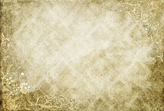 Aged and yellowed vintage paper background. Stained and yellowed paper with old-fashioned floral patterns. Old dirty wallpaper Stock Photos