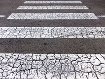 Aged zebra crossing. Grunge pedestrian zebra crossing detail Royalty Free Stock Photos