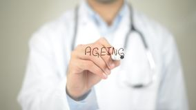 Ageing , Doctor writing on transparent screen stock photos
