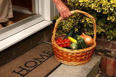 Ageing Hand Reaching For  Vegetable Basket. Royalty Free Stock Images