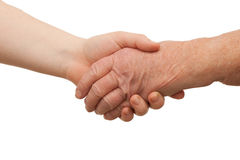 Ageing - Handshake between young and old women Stock Photo