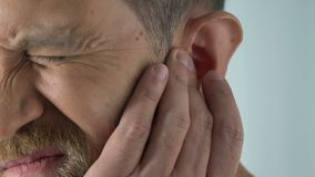 Ageing male has ear ache after catching draft, bacterial infection, otitis pain