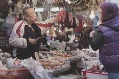 Ageing population in Hong Kong. HONG KONG - JANUARY 4: A Hong Kong old man is working at his stall in Hong Kong on January 4, 2014. Ageing population problem is royalty free stock image
