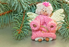 Agel with wedding ring. Christmas angel with a gift Stock Images