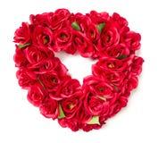 Agencement rouge en forme de coeur de Rose sur le blanc Images stock