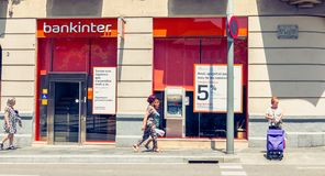 Agency of the company Bankinter, a Spanish banking company. BARCELONA, SPAIN - June 20, 2017 : people walk in front of a bank branch of the company Bankinter, a Royalty Free Stock Image