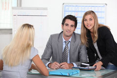 Agency. Estate agency employees with a client stock images