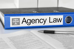 Agency Law. Blue folder with the label Agency Law stock images
