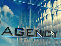Agency. Reflections in front of a agency building Royalty Free Stock Photos