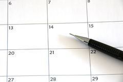 Agenda. Making a planning or note in the agenda with a pencil for the day or week in office royalty free stock image