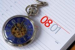 Agenda. A closeup of an old clock above an agenda Stock Image